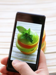 smartphone shot food photo - slices green apple and orange
