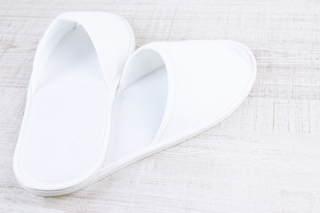 White slippers on wooden background
