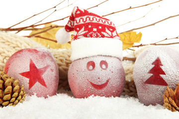 Holiday apples with frosted drawings in snow close up