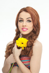 Portrait of beautiful girl in studio with yellow chrysanthemum