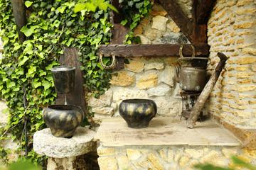 Old retro cauldrons in garden