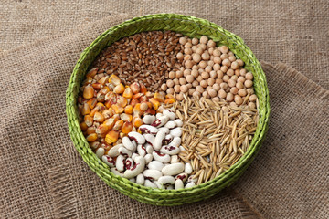 Cereals in bowl on burlap background