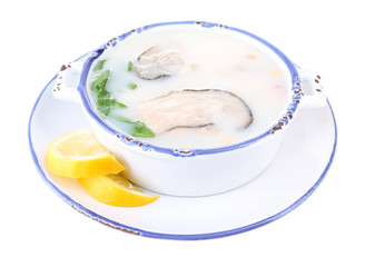 Tasty soup with oysters, isolated on white