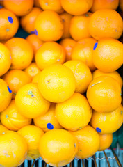 oranges in supermarket cart