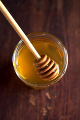 Fresh organic yellow honey in a jar