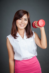 Happy Asian girl hold a dumbbell and smile