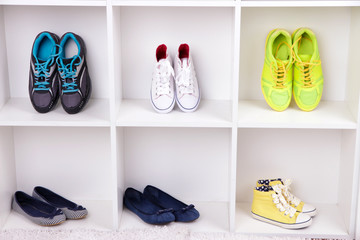 Colorful shoes on wooden shelves