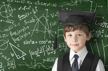 boy near blackboard with formulas