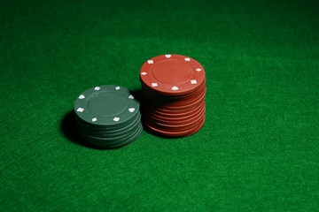 Chips for poker on green table