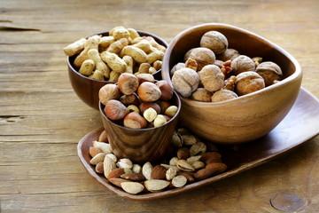 different kinds of nuts (almonds, walnuts, hazelnuts, peanuts)
