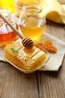 Leinwandbild Motiv Fresh honey on wooden table