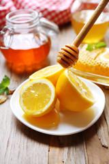 Lemon and honey on wooden table