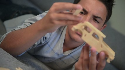 Teenager-Child making mounting a car model at home