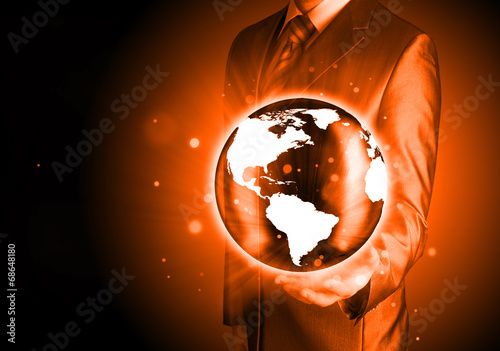 canvas print picture Businessman holds Earth in a hand