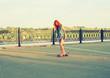 Skater caucasian women on skateboard at sunrise