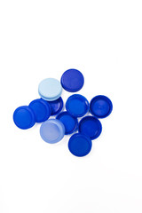 bunch of blue plastic caps from bottles of water