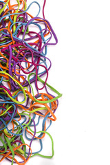 unordered pile of colorful elastic rubber bands