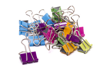 pile of several colorful office binder clips