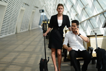 young business people waiting in a public transportation station