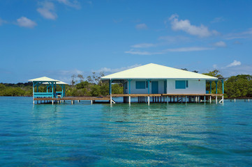 Caribbean house on stilts over water