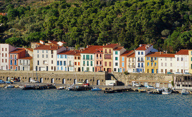 Colorful waterfront houses in a French harbor