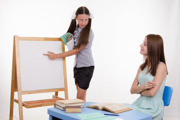 The pupil answers at blackboard in classroom
