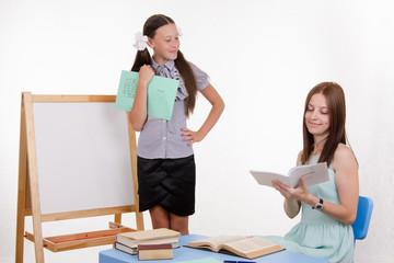 Teacher puts exellent student