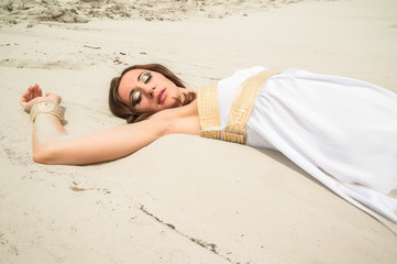 Young pretty woman in greek tunic