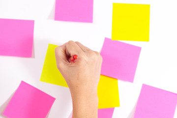 Writing on screen- Wall covered with sticky notes