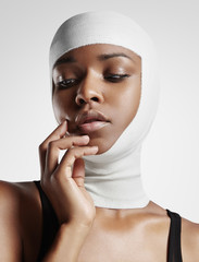 black woman with bandaged head