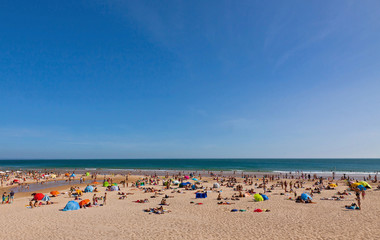 Crowded Atlantic summer beach in Portugal