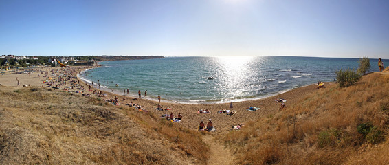 Panoramic view of crowded summer beach in Sevastopol, Crimea pen