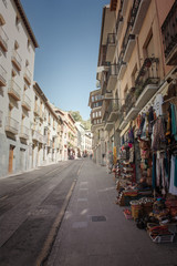 Street old houses stores Granada Spain.
