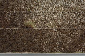 Stone wall grass background