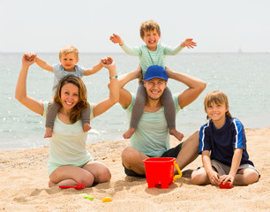 Parents with kids at seaside