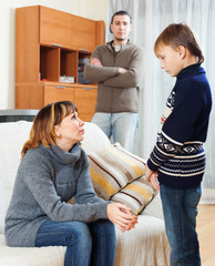 Mother and father  scolding teenager son
