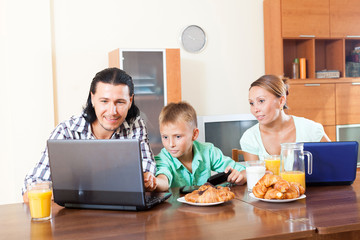 family communicating over breakfast at home in morning