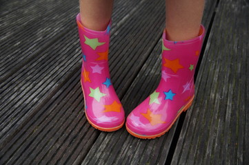 Child legs in rubber boots (galoshes) - shy