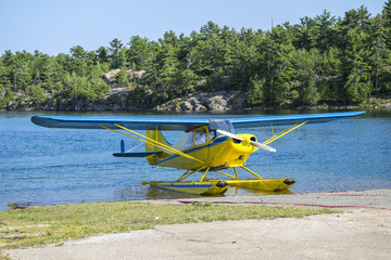 Blue and Yellow Float Plane on a Lake