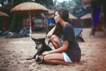 Young beautiful woman with curly hair and dog