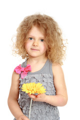 Little girl holding bunch of flowers.