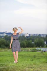 Woman in field looks in a distance