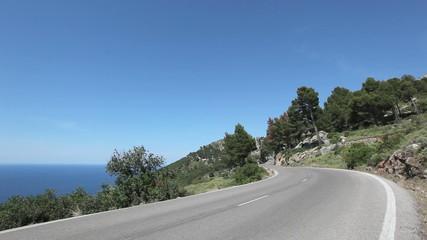 Asphalt road along a sea coastline on Mallorca, Spain