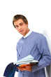 canvas print picture - Young college guy  holding a books