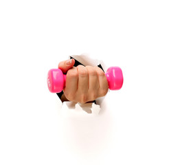 Woman hand holding dumbell,through the wall