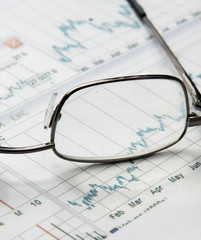 Eyeglasses lying down on a business document