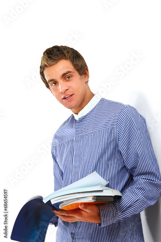 canvas print picture Young college guy  holding a books