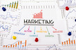 Leinwandbild Motiv marketing concept with financial graph and chart