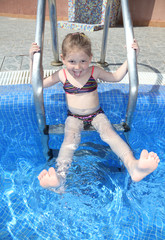 Little girl having fun at the pool