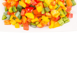 Mix colorful chopped capsicums in a plate over white background